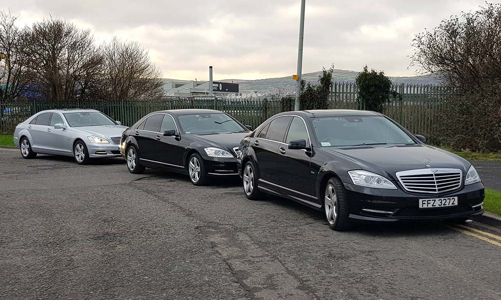 3 Mercedes parked at the docks