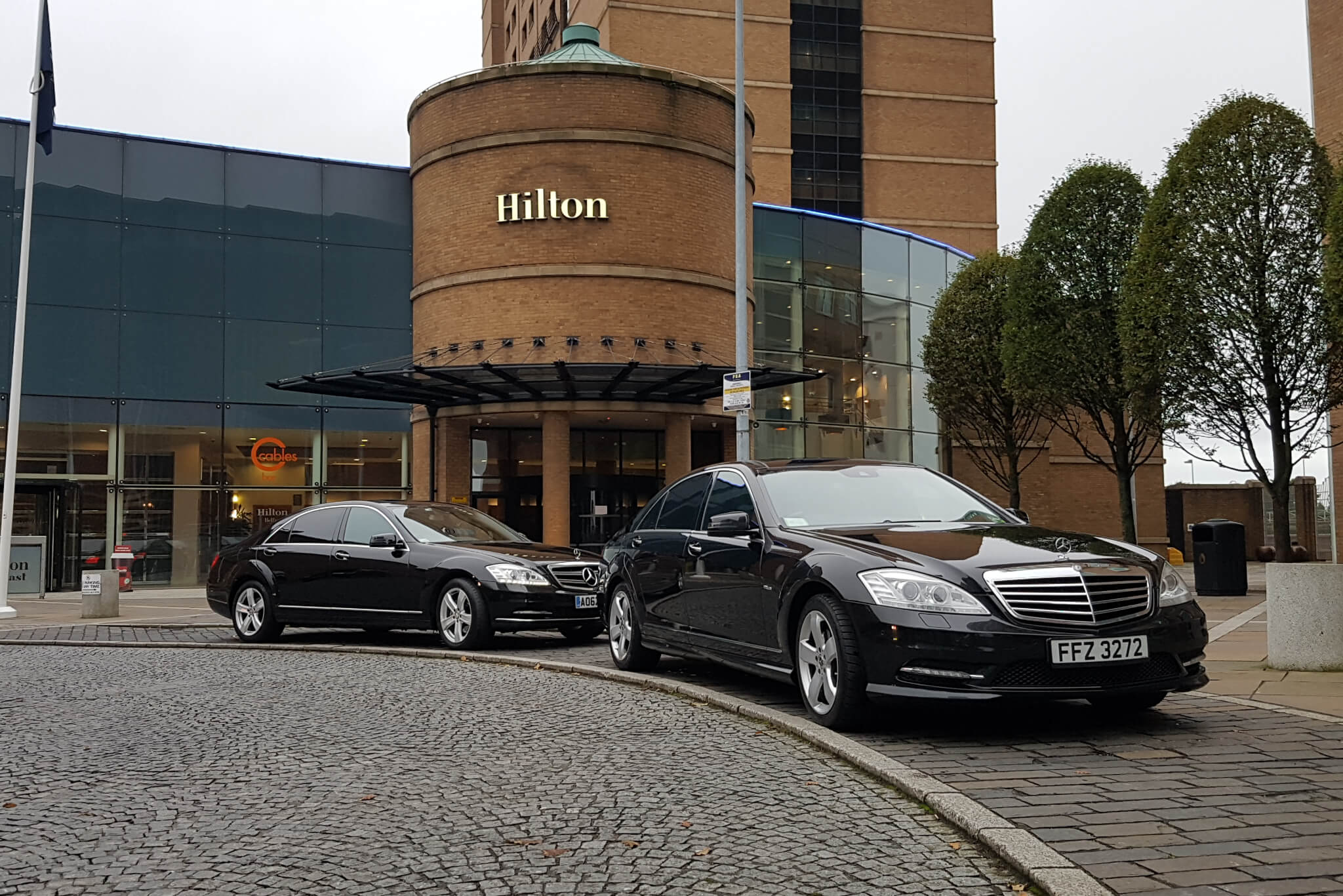 2 Mercedes parked at the Hilton Hotel